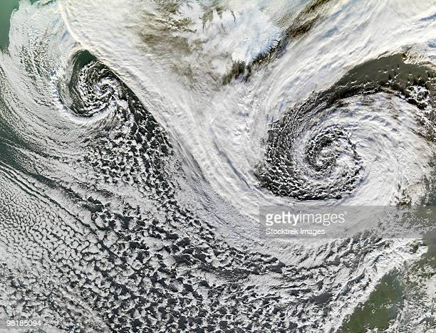 Two cyclones formed in tandem south of Iceland.  Scotland appears in the lower right.