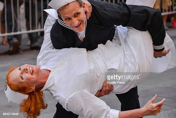 Two dancers dressed as the sailor and nurse in Eisenstaedt's iconic photograph dance before the start of the Times Square kissinTo mark the 70th...