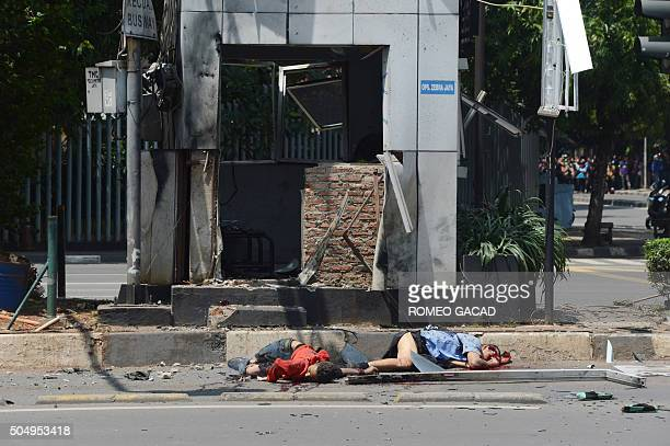 Two dead bodies are seen outside the bombdamaged traffic police outpost near a damaged Starbucks coffee shop after a series of explosions hit central...