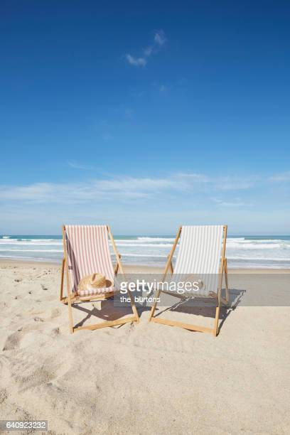 Two deck chairs at beach