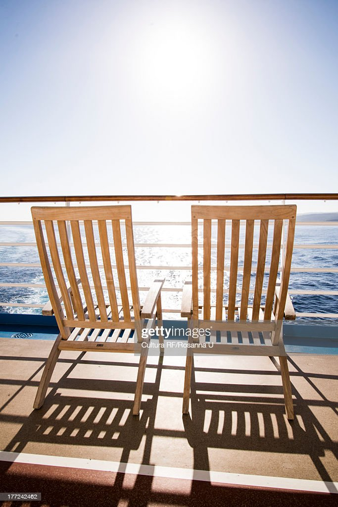 two deckchairs on cruise ship at sea falmouth jamaica stock photo