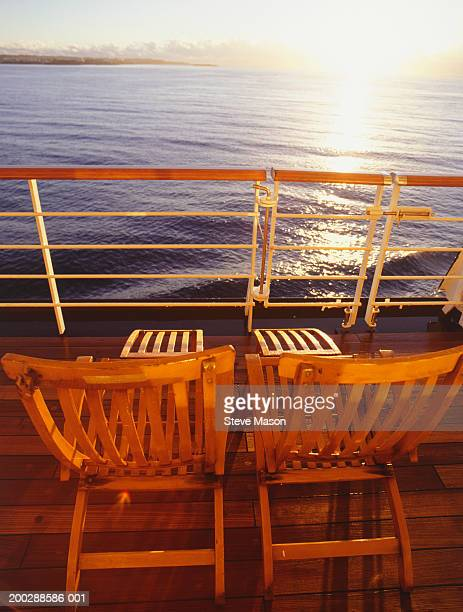 Two deckchairs side by side on cruise ship deck