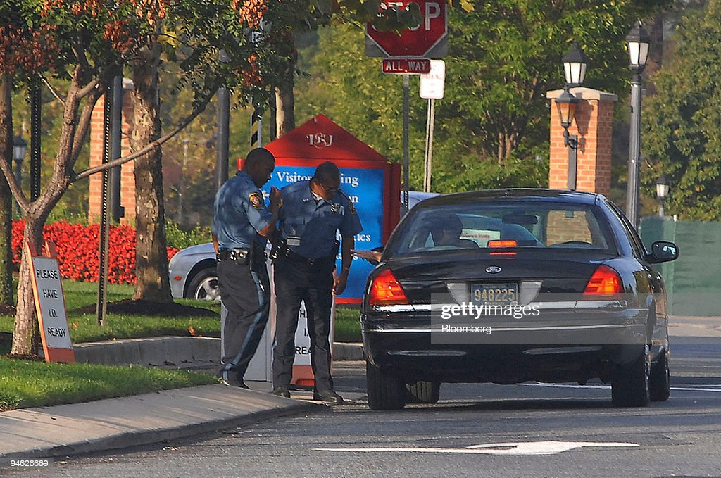 Two Delaware State Policemen stand at the entrance to the Delaware State University campus in Dover Delaware US on Friday Sept 21 2007 Two Delaware...
