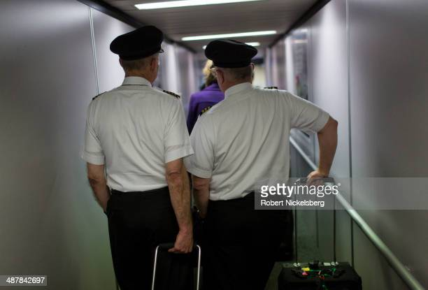 Two Delta Air Lines pilots wait to board a plane April 16 2014 at the MinneapolisSt Paul International Airport in Minneapolis Minnesota