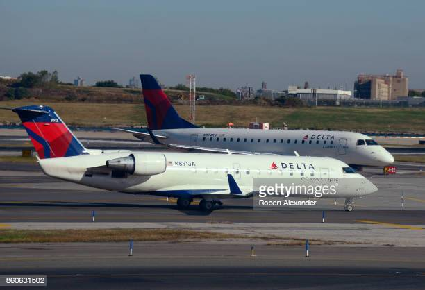 Two Delta Connection passenger jets taxi at LaGuardia Airport in New York New York