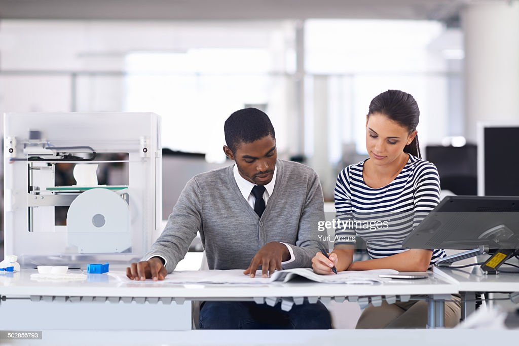Two designer heads are better than one : Stock Photo