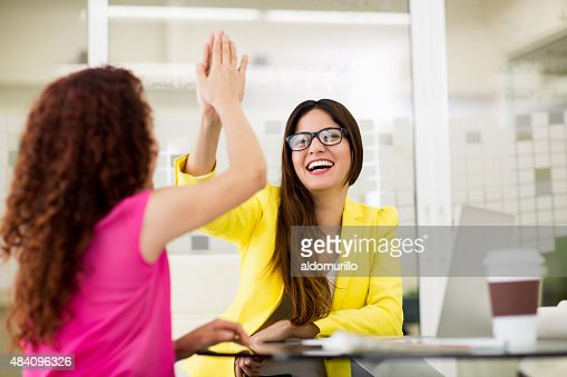 Two designers giving high five to each other