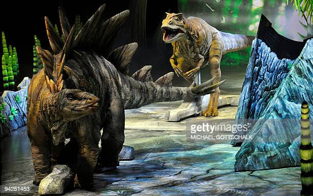 Two dinosaurs fight during a photo rehearsal of the show 'Dinosaurs in the empire of giants' in Berlin on December 10 2009 The show takes place from...