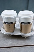 Two disposable coffee cups