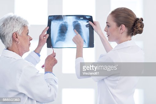 Two doctors discussing x-ray
