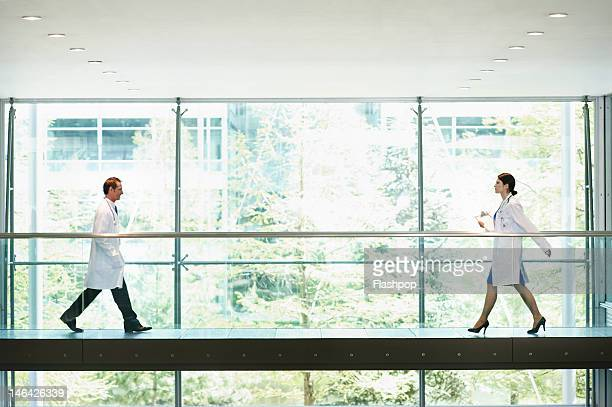 Two doctors walking, on the move