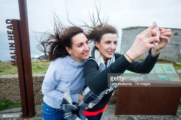 Two Donegal locals take a selfie at Banba's Crown Malin Head CoDonegal Ireland as Hurricane Ophelia hits the UK and Ireland with gusts of up to 80mph