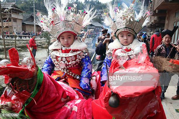 Two Dong children take part in a Taiguanren Festival to pray for blessings in new year on February 15 2016 in Liping County in Qiendongnan Miao and...