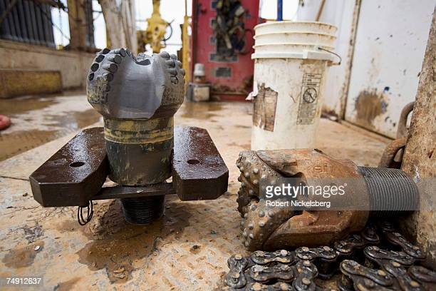Two drilling bits lie on the floor of a natural gas drilling rig on June 6 outside of Artesia in eastern New Mexico The vast petroleum and natural...