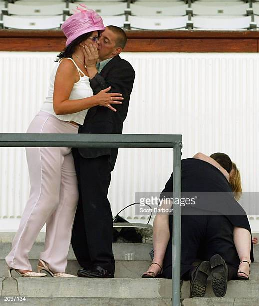 Two drunk racegoers embrace after the last race of the third day of the Royal Ascot horse racing week June 19 2003 in Ascot England Royal Ascot is...