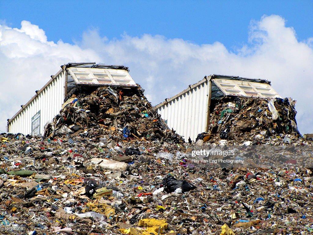 Two dump trucks at landfill : Stock Photo