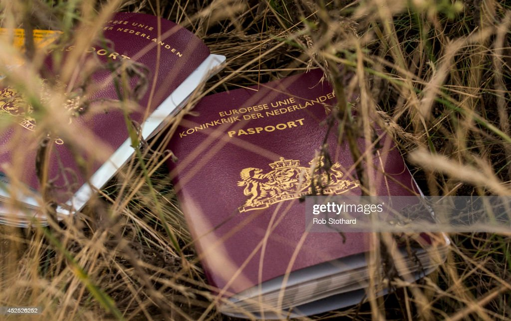 Two Dutch passports lie in a field amongst luggage, personal belongings and wreckage from Malaysia Airlines flight MH17 on July 22, 2014 in Grabovo, Ukraine. Malaysia Airlines flight MH17 was travelling from Amsterdam to Kuala Lumpur when it crashed killing all 298 on board including 80 children. The aircraft was allegedly shot down by a missile and investigations continue over the perpetrators of the attack.