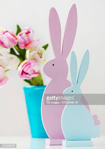 Two Easter bunnies with flowers
