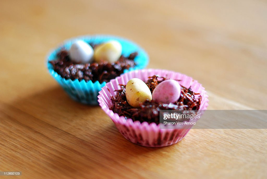 Two Easter egg cakes in coloured cake cases : Stock Photo