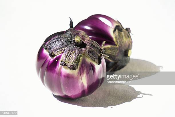 Two eggplants on white background, close up