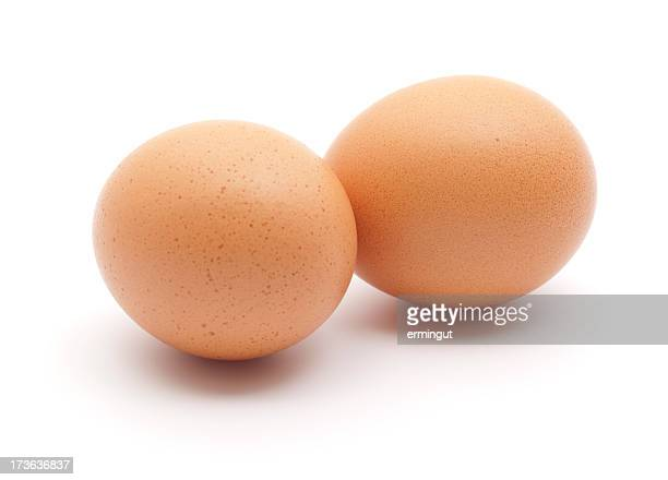 Two eggs isolated on white.