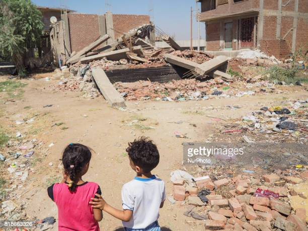 Two Egyptian children family standing in front of a destroyed house in alWarraq Island Giza Egypt 18 July 2017 Clashes broke at the island of...