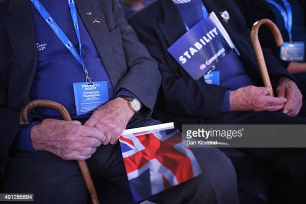 Two elderly delegates listen to speaches during day one of the Conservative Party Conference on October 4 2015 in Manchester England Up to 80000...
