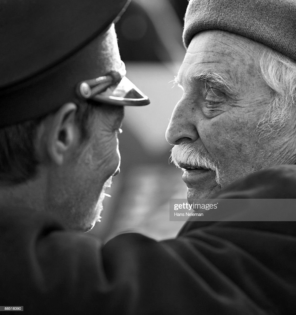 Two elderly men sharing a moment : Stock Photo