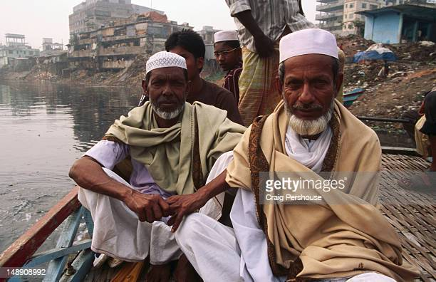Two elderly Muslim men on tolar (motorised passenger boat) on Tongi River.