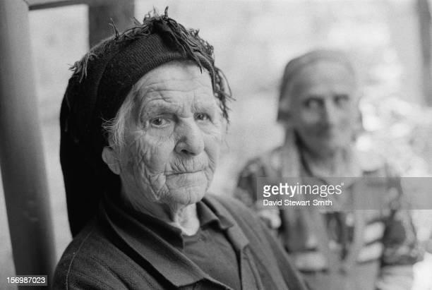 Two elderly women in the unrecognized state of NagornoKarabakh within Azerbaijan during the NagornoKarabakh War June 1993