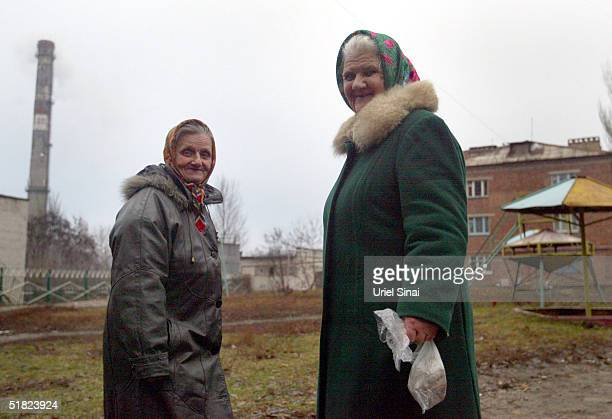 Two elderly women stand outside December 4 2004 in Donetsk Ukraine The city with a population of over 1 million is situated in the south east of the...