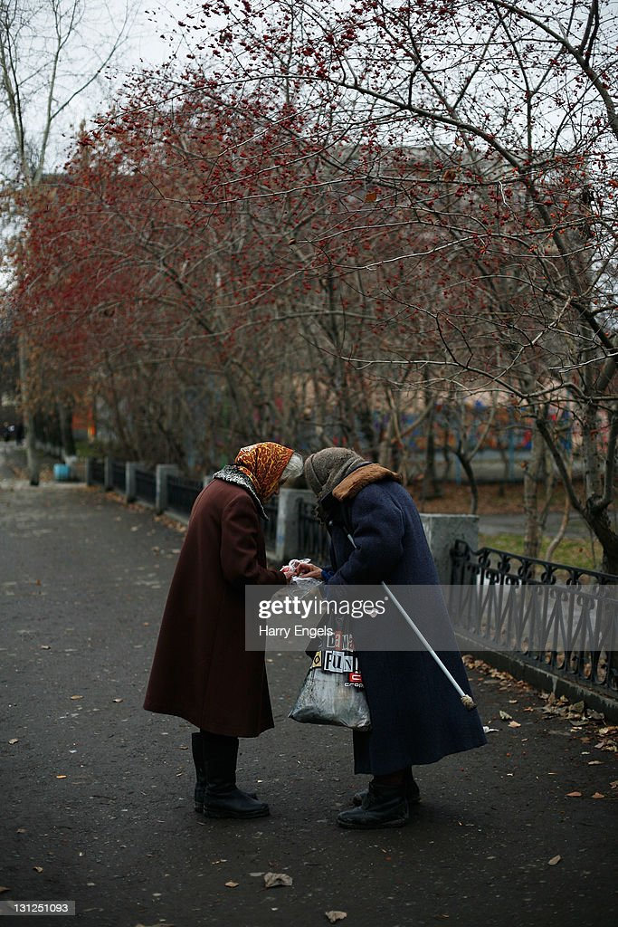 Two elderly women talk on November 3, 2011 in Yekaterinburg, Russia. Yekaterinburg is one of thirteen cities proposed as a host city for the 2018 FIFA World Cup in Russia.