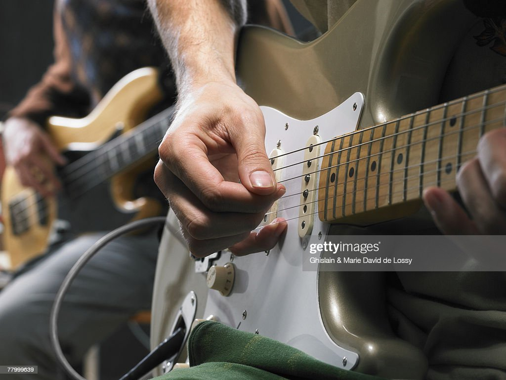 Two electric guitar players close up on hands. : Stock Photo