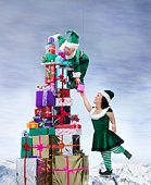 Two 'Elves' by large pile of presents (digital composite)