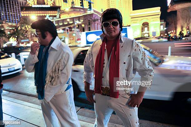 Two Elvis Presley impersonators stand on Las Vegas Blvd in Las Vegas Nevada US on Saturday Jan 28 2012 The Nevada Republican presidential caucus will...