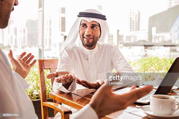 Two Emirates business men sitting in a cafe