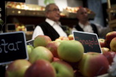 Two employee offer the apple variety Jonagold and other different varieties at a stand at the Gruene Woche agricultural trade fair on January 20 2014...