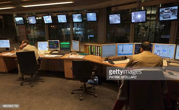 Two employees sit in the controlroom at the blast furnace at the ThyssenKrupp steel mill Hamborn on December 12 2014 in Duisburg western Germany AFP...