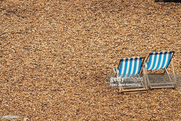 Two Empty Beach Chairs on Brighton and Hove Beach