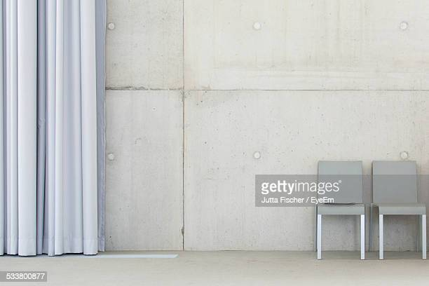 Two Empty Chairs In Room