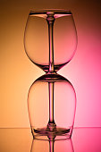 Two empty wineglass for red wine on diffusion lit background in abstract
