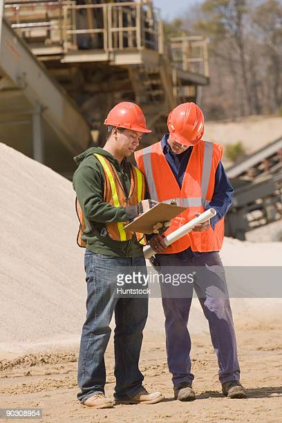 Two engineers discussing at a gravel and asphalt plant