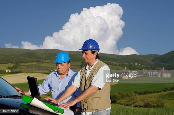 Two Engineers Planning PC in the Countryside