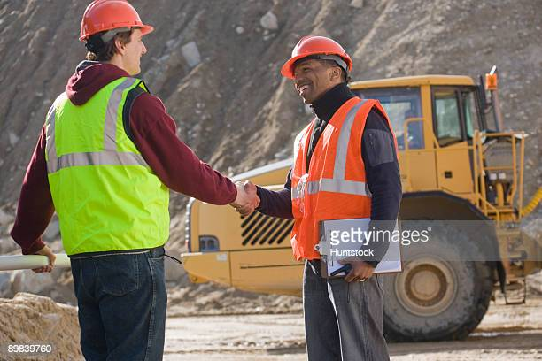 Two engineers shaking hands
