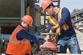 Two engineers working at a gravel and asphalt plant