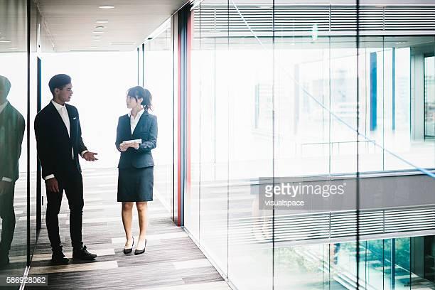 Two Entrepreneurs Walking Down the Hallway