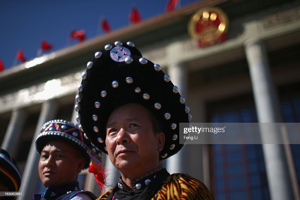 Two ethnic minority delegates walk out the Great Hall of the People after attending a pre-opening session of the National People's Congress, China's parliament, on March 4, 2013 in Beijing, China. China's defensive military policies have played a core role in maintaining peace and stability in Asia, a spokesperson for the annual session of China's national legislature said Monday.