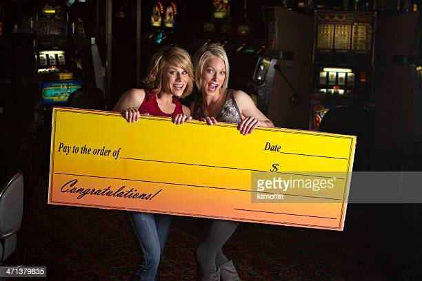 Two Excited Women In Casino with Giant Check