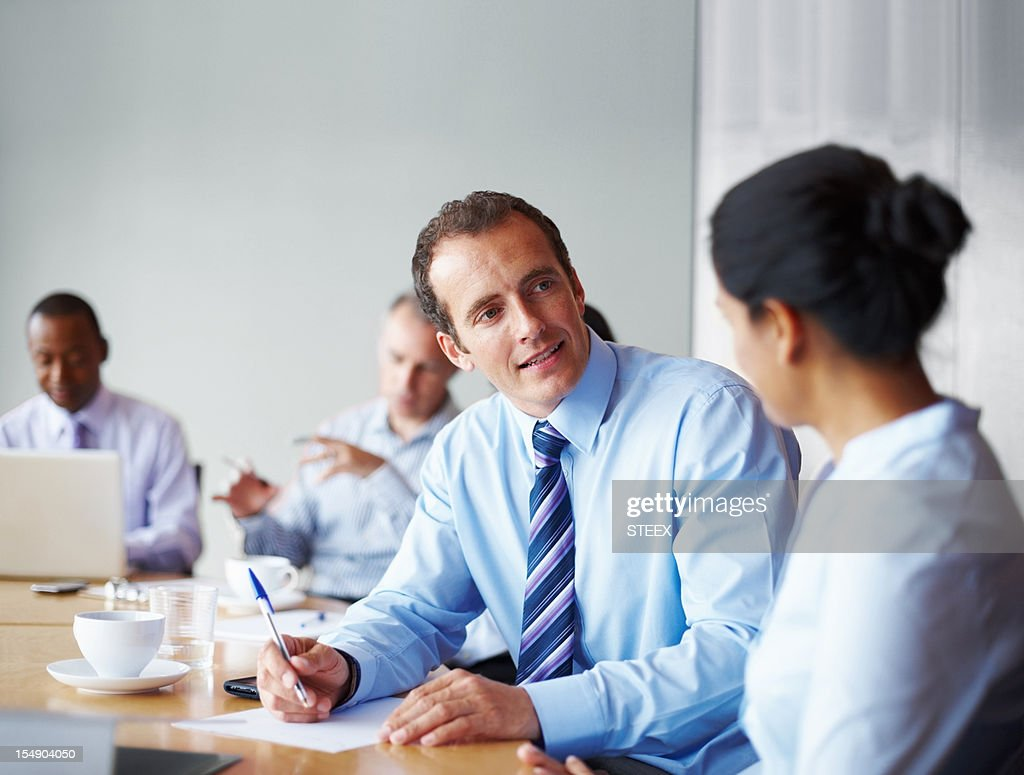 Two executives having quick discussion in meeting : Stock Photo