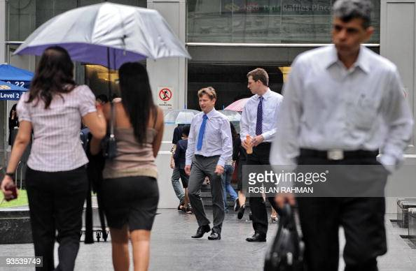 Two expatriate western businessmen walk out during their lunch break in the financial district of Raffles Place in Singapore on December 2 2009...